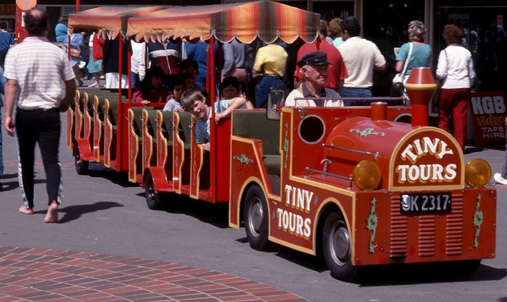 The Tiny Tours train in New Brighton Mall. The train was owned and driven by the Late Dave Gaynor. November 1986. Christchurch, New Zealand