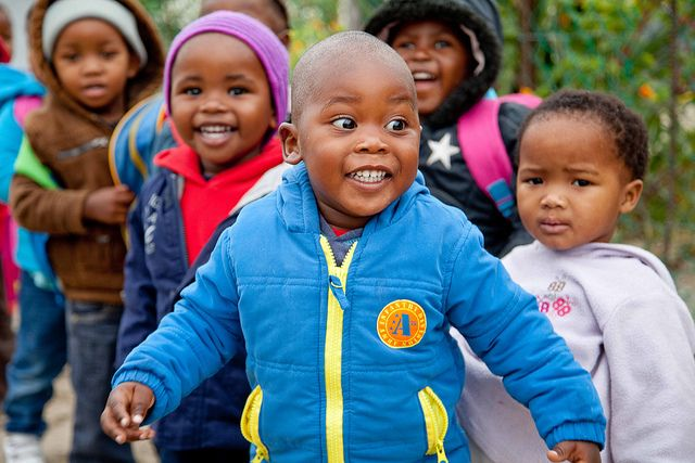 Transforming Ncedolwethu Educare by See-Saw-Do. Love the reaction on this little guy's face after he saw their play-school's makeover for the first time!