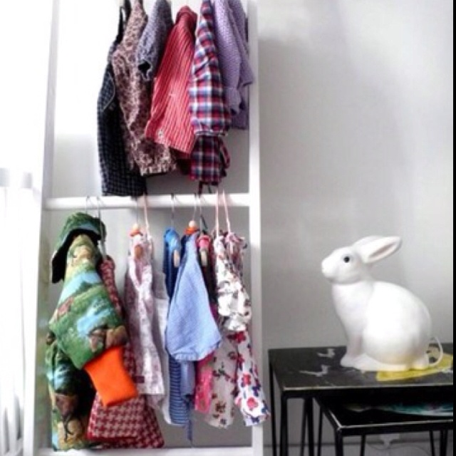 Use A Ladder To Hang Baby Clothes For A Small Nursery