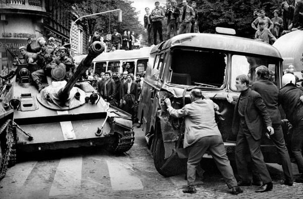 "Citizens of Prague block a tank trying to end the ""Prague Spring,"" August 21, 1968. By Bohumil Dobrovolsky."