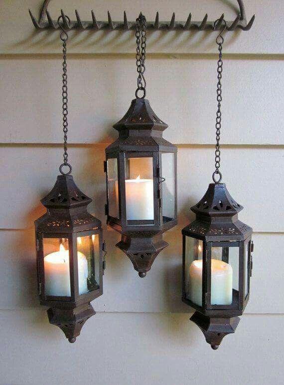 metal lanterns hung on a vintage rake porch lightingoutdoor louisville decorative outdoor lighting adds mystique y