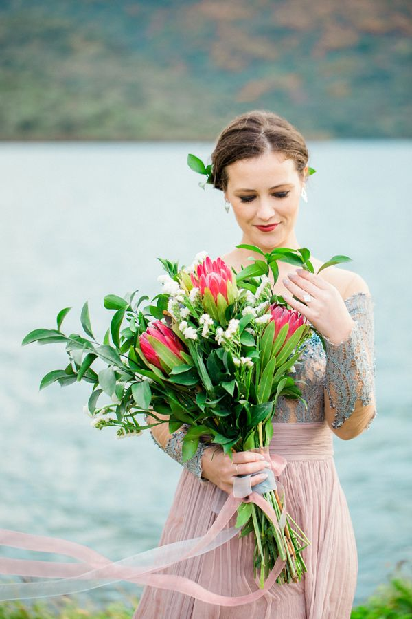 bouquet with protea - photo by 135milimetros http://ruffledblog.com/mountaintop-bridal-inspiration