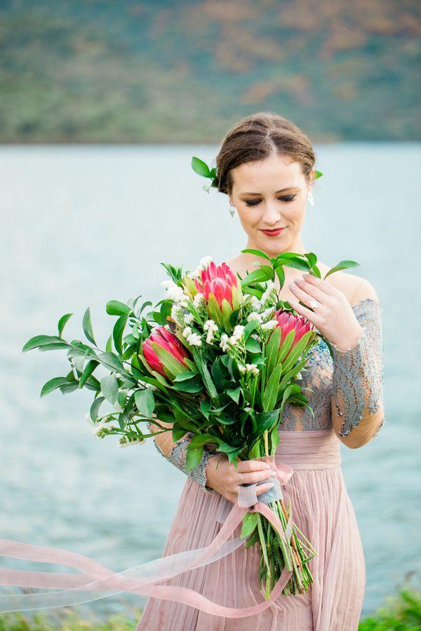 bouquet with protea - photo by 135milimetros http://ruffledblog.com/mountaintop-bridal-inspiration