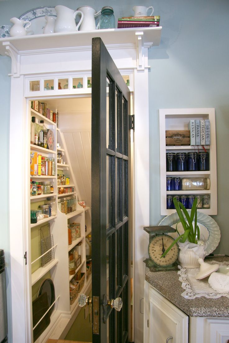 Shelf over the door and pantry under the stairs. I like the glass door which lets in natural light. Consider that for the door at the top of the basement stairs.