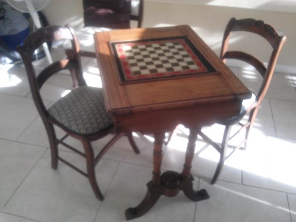 Beautiful victorian era chess table with 2 chairs. Original painted glass chess board and ORIGINAL FABRIC seat covers - a handful (not complete) of original cast iron chess pieces - in amazing condition for the age!! worth much more but in this economy... good luck.