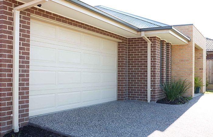A Sectional Casey Garage Door Whether Lively Painted Colorbond Or Bluescope Wood Look Is Sectional Garage Doors Garage Door Installation Door Installation