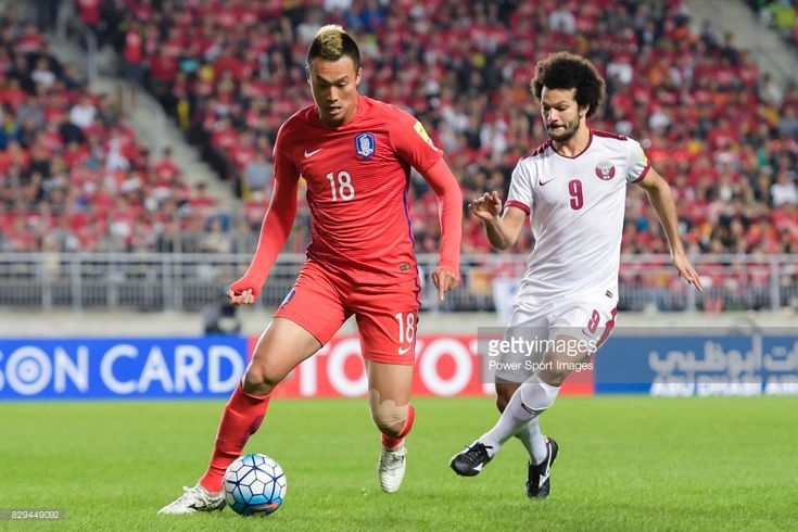 Kim Shinwook (L) of Korea Republic fights for the ball with Ahmed El Sayed (R) of Qatar during the 2018 FIFA World Cup Russia Asian Qualifiers Final Qualification Round Group A match between Korea Republic vs Qatar at Suwon World Cup Stadium on 06 October 2016, in Suwon, South Korea.