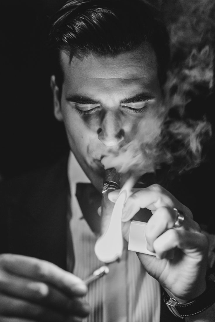 Groom smoking cigar; PHOTOGRAPHY Joel + Justyna Bedford;