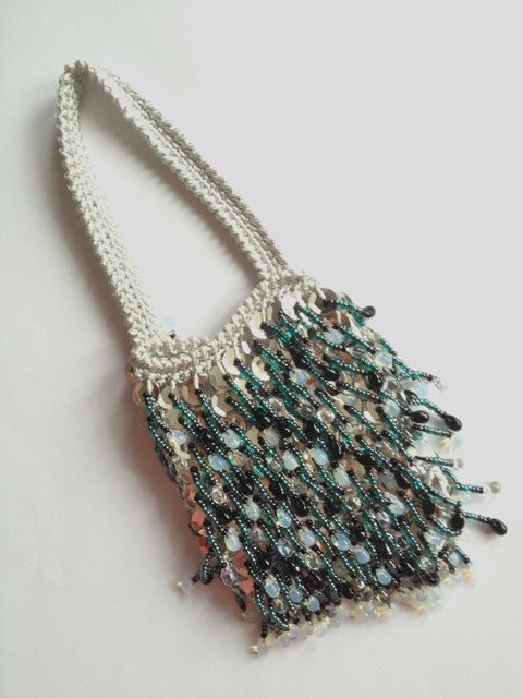 LOVE LOVE LOVE this.    Intricate sequin beaded wrist purse/pouch/bag by Cyclopaedia, £39.80