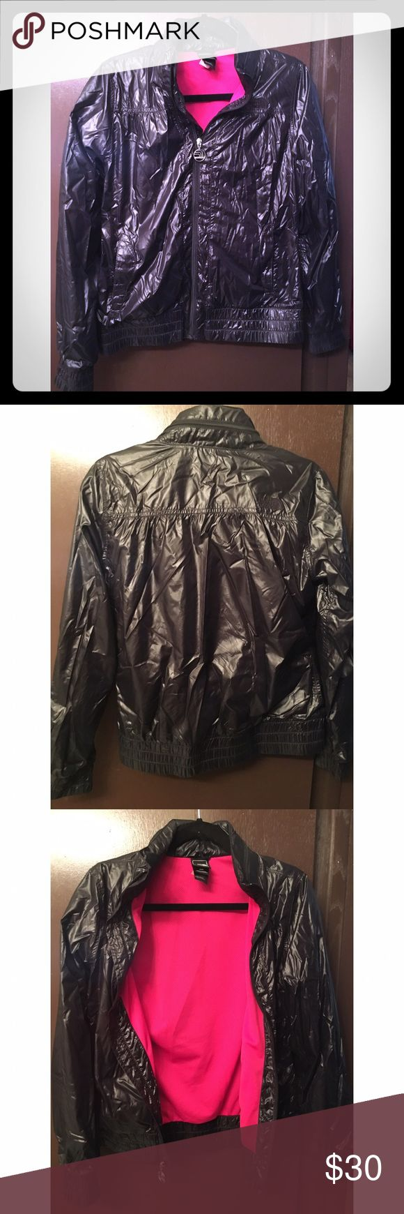 The North Face Windbreaker LIKE NEW The North Face black and pink windbreaker. Has a zipped up hood (see photo of back). Excellent condition. Size Medium North Face Jackets & Coats