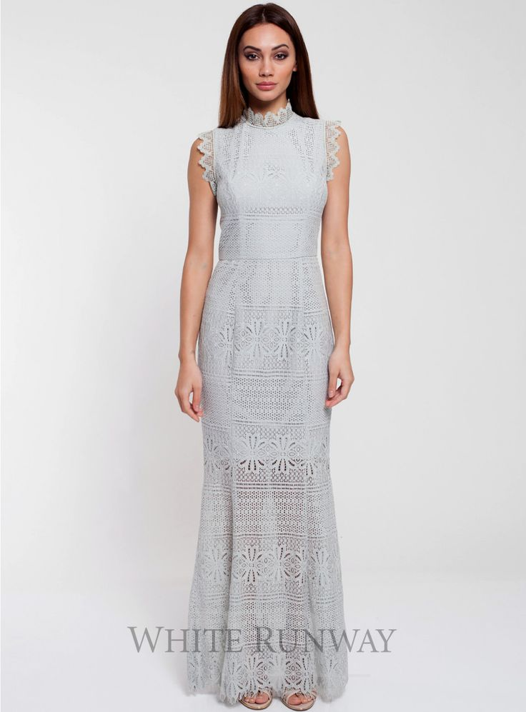 Ruby Maxi. A gorgeous maxi dress by Romance the Label. A high neck style featuring a sheer skirt and lace trimming on the neckline and shoulders.