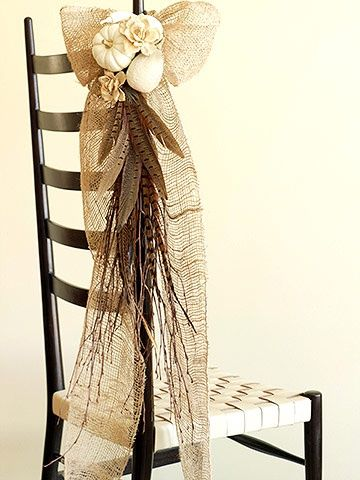 Beautiful burlap, feathers, and flowers chair decor #diywedding #fallwedding #rustic #autumn #weddingdecor