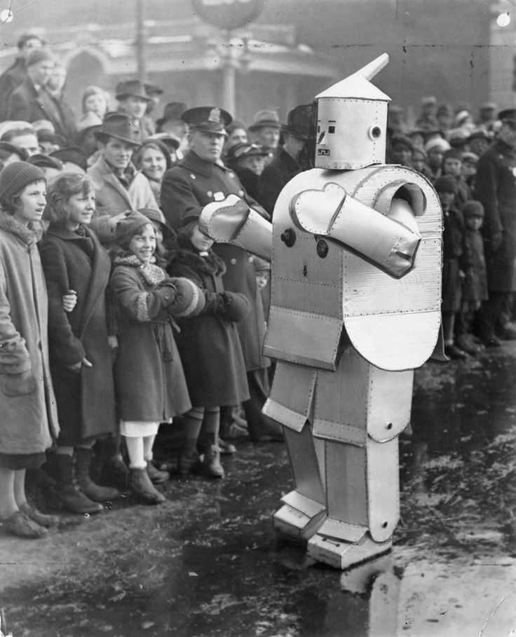 """The Mechanical man. George German, of the Lobster Club, was the human robot in the annual Mummers' Parade today. He demonstrated the mechanical man of the future.""  1936, Jan. 1."