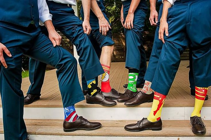 Get sneaky geeky with superhero socks for your wedding party   Photo by Art of Roxy Photography