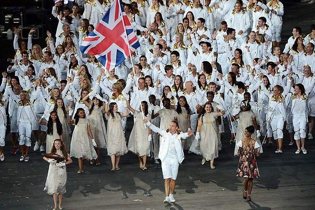 Sir Chris Hoy of the Great Britain Olympic cycling team carries his country's flag. Picture: Getty Images