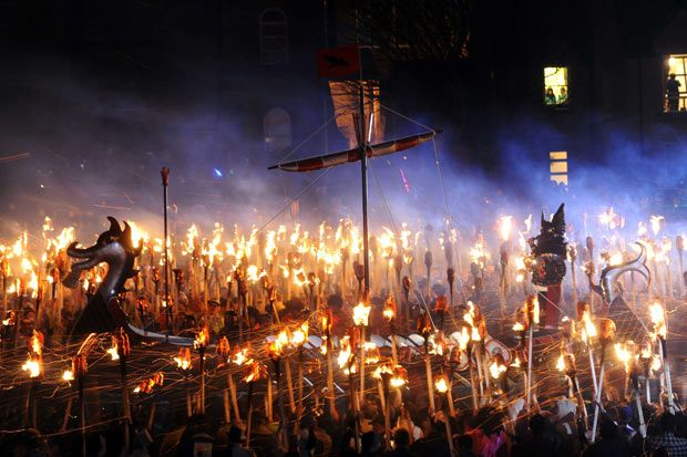 Members of the Viking Jarl Squad surround their leader or 'Guizer Jarl' on a Viking galley ship during the annual Up Helly Aa Festival in the Shetland Islands of Lerwick. Up Helly Aa celebrates the influence of the Scandinavian vikings in the Shetland Islands. The event culminates with up to 1,000 'guizers' (men in costume) throwing flaming torches into a Viking longship.    Members of the Viking Jarl Squad surround their leader or 'Guizer Jarl' on a Viking galley ship during the annual Up…