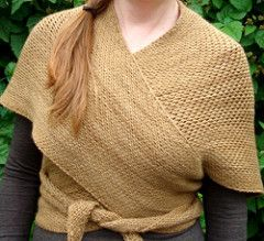 Shawl is inspired by a traditional Norwegian design, and is made to wrap around the body and tie at the front.