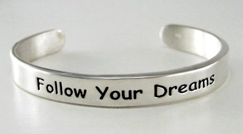 """""""Follow Your Dreams"""" on a Sterling Silver Cuff Bracelet...Says it All The Silver Dragon- Bracelets. $170.00. Sure to bring on the compliments!. This Bracelet Fits a Standard Woman's Wrist. Sterling Silver Made in the USA, giving American's jobs.. This Bracelt is a lovely Reminder to Someone Special. Our jewelry is made with reclaimed silver ...saving the earth's natural resources."""