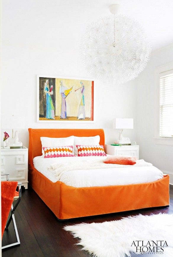 Leaving everything white, then adding punches of color with orange bed frame and patterned pillows.  Also great addition of the textural light fixture (ikea!)