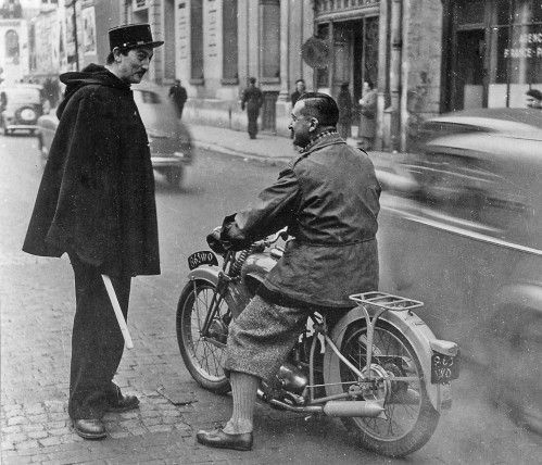 1949. Daniel Rebour, editor at Moto Revue magazine, located nearby on rue de Cléry, doing a road test to review the Peugeot 125 (or at least it looks like the old Peugots)