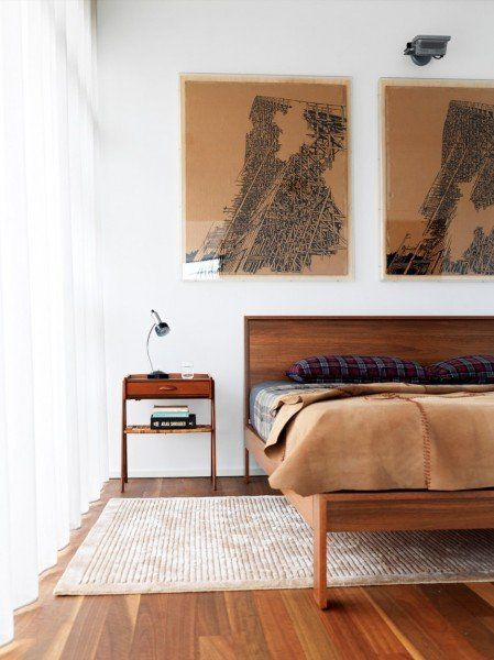 Mid Century Modern Platform Bed mixed with similar wood tones and white walls.