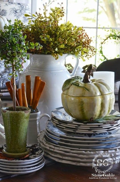 Stacked dishes, pumpkin tureen... Fall decor in the dining room!