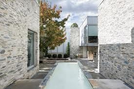 shist fireplace internal courtyard- THIS COLOUR STONE.
