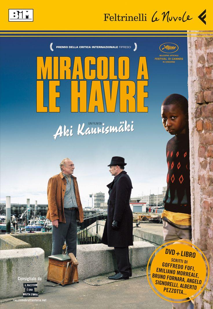 """Aki Kaurismäki, """"Miracolo a Le Havre"""". Miracolo a Le Havre è semplicemente un film di Aki Kaurismäki: i colori vividi di un mondo sospeso nel tempo, lo sguardo fisso oltre il confine dell'inquadratura di personaggi che sembrano sagome laconiche ma poi sono capaci, sempre, di un salvifico calore umano. Perché oggi, per essere realisti, basta la capacità di sognare."""