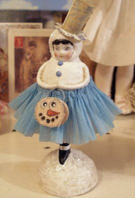 Not quite a snowman, but she is carrying one.