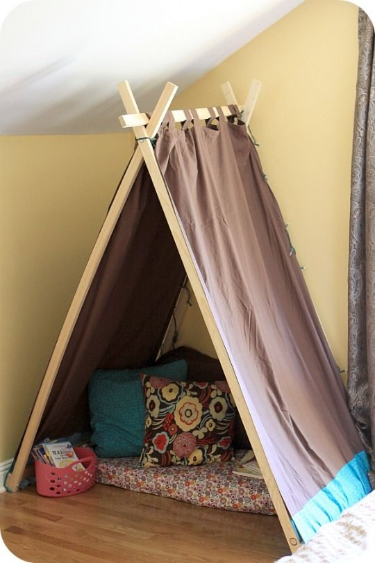 love this reading nook made with a little wood and some curtains and cushions for a cosy corner in the playroom with the wall bookshelf we have for that room mounted beside it