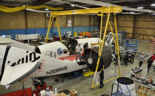 Virgin Galactic - showing the biggest single component of our new hybrid rocket motor, the main nitrous oxide tank, being installed into the spaceship.