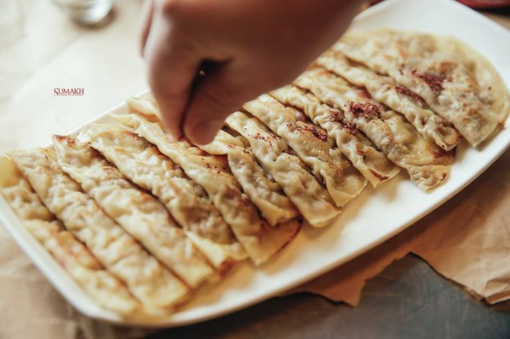 Azerbaijani Cuisine. Meat kutabs. Pancake filled with minced mutton onion and pomegranate.