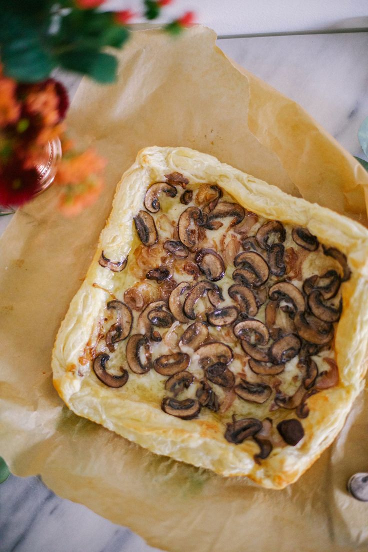 I love cooking with puff pastry. It's like cheater croissant dough and elevates the simplest of appetizers. Over the winter I experimented with a couple of puff pastry recipes and after rigorous research and development (which employed the help of other hungry mouths), I found that this gruyere mushroom puff pastry tart would be simple