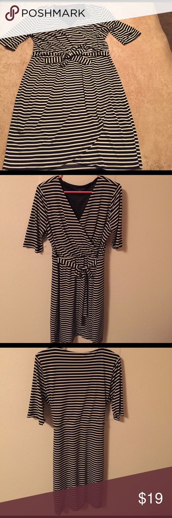 Beautiful dress! Worn once nice stretchy dress. Camouflages tummy and good form to a curvy body. Great with tights and and boots or with some heels. Covington Dresses Mini