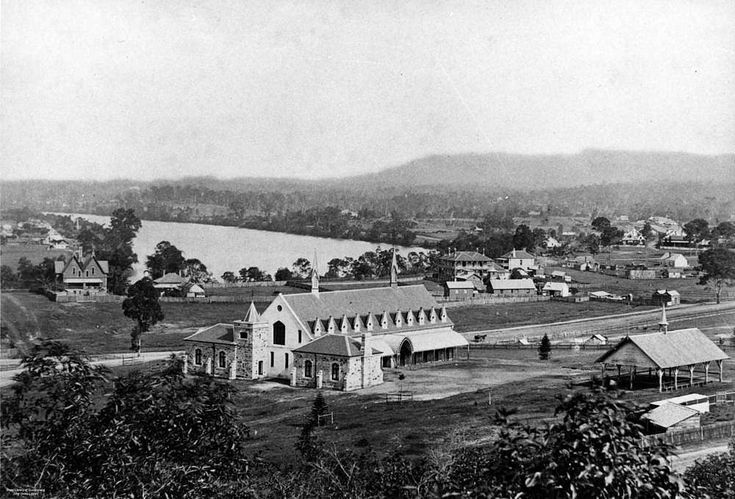First Brisbane Grammar School, Roma St, Brisbane, 1874. Situated on the railway side of the road at approximately the junction of Roma, George and Herschel Sts. Soon after the school opened in 1869, the Ipswich to Brisbane railway was built as far as Roma St. Growing railway activities forced the Trustees to move the school to its present site in Gregory Tce. The first site is now part of the Roma St Railway Station complex and the school building was used for some time as Railway Dept…