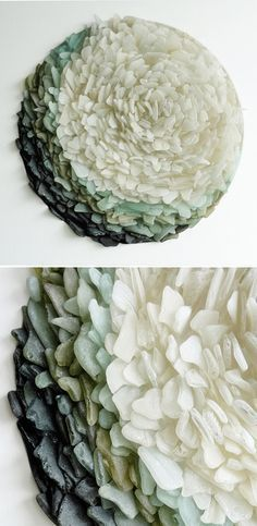 UK based artist Jonathan Fuller uses bits of wave-worn glass he's gathered along the Cornish coastline. Beautifully gradated sea glass, embedded into cut wood panels.