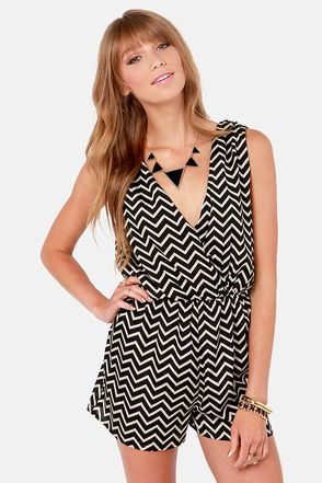 Check it out from Lulus.com! Do you think chevrons have hit their peak yet? When we look at the Great Inclinations Beige and Black Chevron Print Romper we certainly think so! Black and beige stripes zigzag their way across a sultry surplice bodice that plunges front and back, as well as the cute attached shorts and elastic waistband. Fully lined. Model is wearing a size small. 100�0Polyester. Hand Wash Cold. Made with Love in the U.S.A.