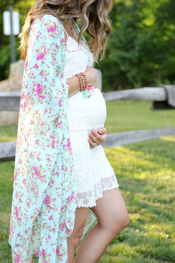 white lace maternity dress and a floral cover up for a future mom
