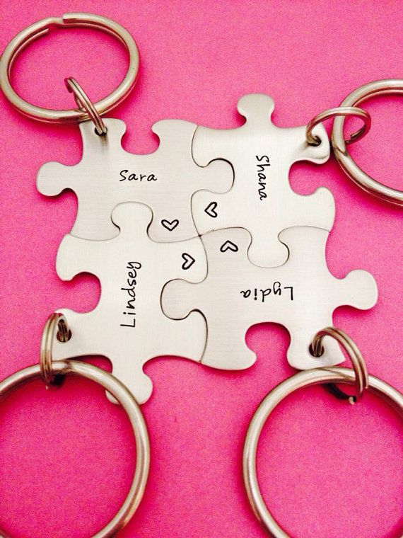 Puzzle piece key chains that are hand stamped, great for wedding favors, Christmas gifts, graduation presents, and gifts for the office!