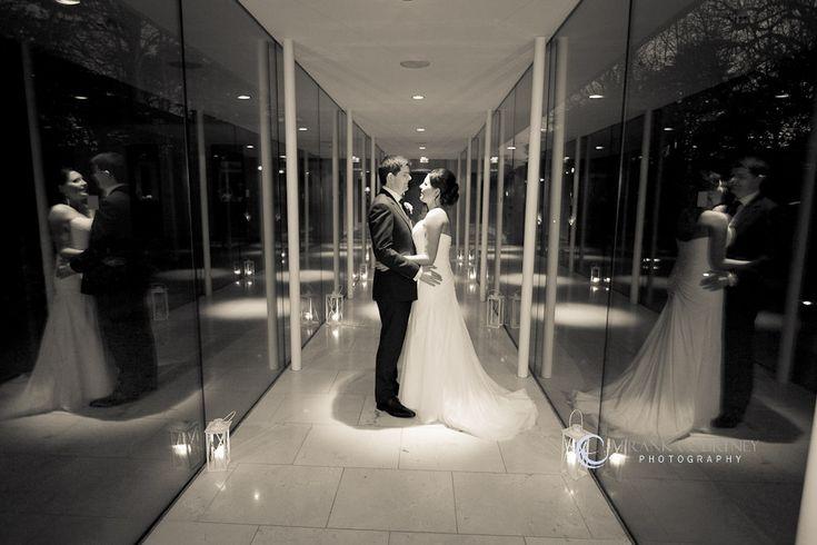 Couple portrait in glass corridor