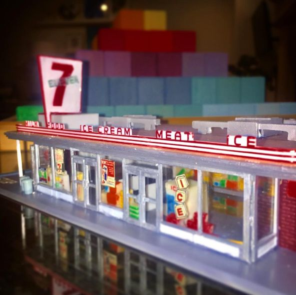"This is a HO scale model of an early 1960s era 7-Eleven store -- likely located in Texas. Originally the convenience stores were known as Tote'm stores because customers ""toted"" away their purchases...but in 1946, the Tote'm name changed to 7‑Eleven to reflect the stores' new, extended hours of 7 a.m. until 11 p.m., seven days a week."