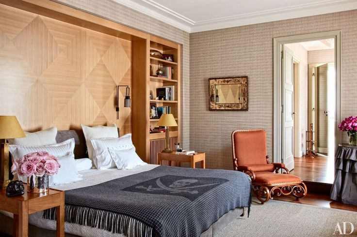 The master bedroom contains an antique Thonet chaise longue upholstered in a Rubelli linen as well as sconces, lamps, and side tables by LB Décoration; the wall covering is by Bisson Bruneel, and the Jolly Roger throw is by Just Divine Cashmere