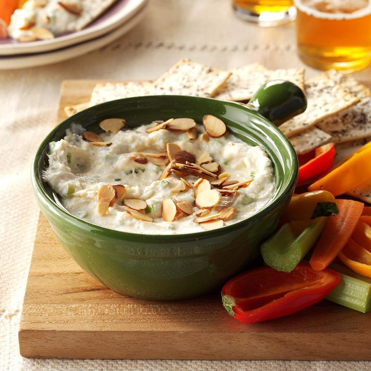 Slow Cooker Crab Dip Recipe -With just 10 minutes of prep time, this creamy and delicious crab dip couldn't be easier. The recipe comes from my hometown cookbook. My co-workers rave about it at every work potluck! —Julie Novotney, Rockwell, Iowa