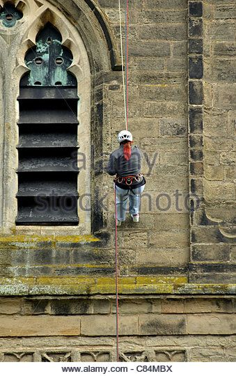 Charity abseiling from roof of St. Mary`s Church, Lutterworth, Leicestershire, England, UK - Stock Image