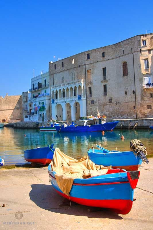 Boats on the shore of Monopoli in Puglia, Italy