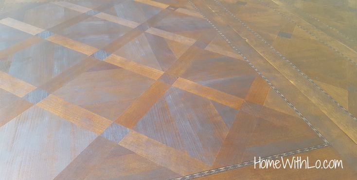How I refinished a wood veneer table top to make it look like solid wood using stain over paint.