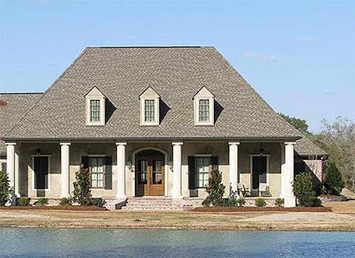 Architectural Designs Acadian House Plan 56364SM looks great on this waterfront lot. Where do YOU want to build it? 3 beds, 2.5 baths, just under 2,700 square feet plus a bonus room with a half bath above the garage for expansion.