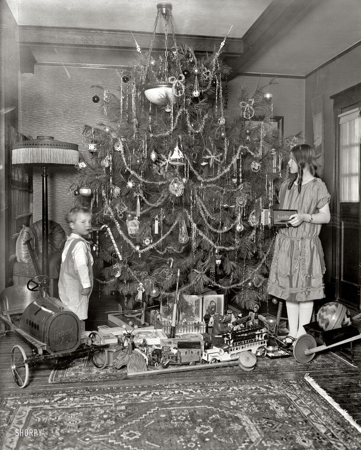 "Washington, D.C., circa 1920. ""Margaret Clark."" A Christmas tree with all the trimmings and a toy Buick."