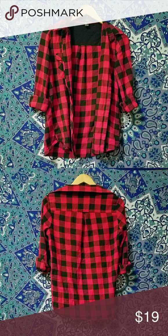 Original Checkered Red and Black Flannel FINAL PRICE! This checkered red and black flannel is in great condition and would go great with black leggings or skinny black jeans or leggings! This checkered red and black flannel is only black and red, with no white stripes like the spin off ones so you will be getting the original 90's look. Not UNIF, tagged for exposure. If you have any questions feel free to leave a comment! :) UNIF Tops Button Down Shirts