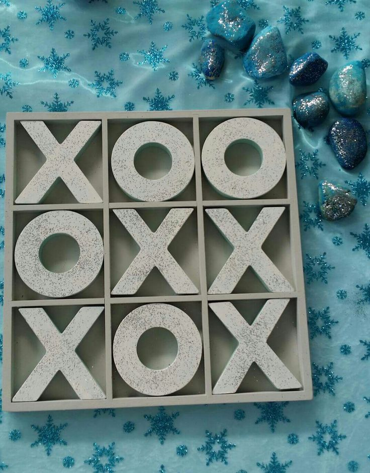 Kmart X & O's painted white with glitter and hand painted rocks.  Kmart hack. Country kids family day care Dimboola.